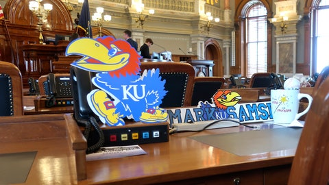 <p>               The desk of Kansas state Rep. Mark Samsel, R-Wellsville, honors University of Kansas sports teams with a sign depicting the Jayhawk mascot, Tuesday, March 10, 2020, on his House chamber desk of the Statehouse in Topeka, Kan. Kansas lawmakers are considering legislation to allow college athletes to hire agents and sign endorsement deals. (AP Photo/John Hanna)             </p>
