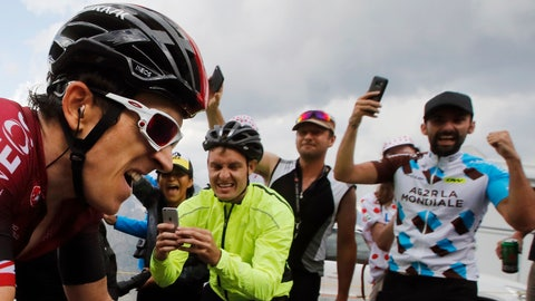 <p>               FILE - In this file photo taken on July 25, 2019 spectators cheer Britain's Geraint Thomas climbing the Galibier pass during the eighteenth stage of the Tour de France cycling race between Embrun and Valloire. Swarms of fans clog the city streets, winding roads and soaring mountain passes of the Tour de France during cycling's three-week showpiece. But unlike almost every other major sporting event it has yet to be called off because of the coronavirus and the start date remains June 27. The new coronavirus causes mild or moderate symptoms for most people, but for some, especially older adults and people with existing health problems, it can cause more severe illness or death. (AP Photo/ Christophe Ena, File)             </p>