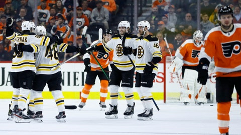 <p>               Boston Bruins' Matt Grzelcyk (48) celebrates with teammates after scoring a goal during the second period of an NHL hockey game against the Philadelphia Flyers, Tuesday, March 10, 2020, in Philadelphia. (AP Photo/Matt Slocum)             </p>