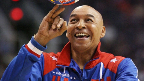 """<p>               The Harlem Globetrotters' Fred """"Curly"""" Neal performs during a timeout in the second quarter in an NBA basketball game between the Indiana Pacers and the Phoenix Suns in Phoenix. Neal, the dribbling wizard who entertained millions with the Harlem Globetrotters for parts of three decades, has died the Globetrotters announced Thursday, March 26, 2020. He was 77. Neal played for the Globetrotters from 1963-85, appearing in more than 6,000 games in 97 countries for the exhibition team known for its combination of comedy and athleticism. (AP Photo/Ross D. Franklin, File)             </p>"""