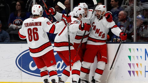 <p>               Carolina Hurricanes center Vincent Trocheck (16) celebrates with teammates center Sebastian Aho (20), right wing Andrei Svechnikov (37) and left wing Teuvo Teravainen (86), after scoring the game winning goal in overtime during an NHL hockey game against the New York Islanders, Saturday, March 7, 2020, in Uniondale, NY. (AP Photo/Jim McIsaac)             </p>