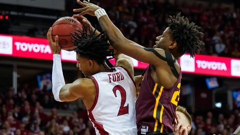 <p>               Wisconsin's Aleem Ford (2) grabs a defensive rebound against Minnesota's Daniel Oturu (25) during the first half of an NCAA college basketball game Sunday, March 1, 2020, in Madison, Wis. (AP Photo/Andy Manis)             </p>