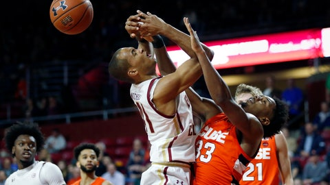 <p>               Syracuse's Elijah Hughes (33) fouls Boston College's Steffon Mitchell (41) during the first half of an NCAA college basketball game, Tuesday, March, 3, 2020, in Boston. (AP Photo/Michael Dwyer)             </p>