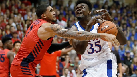 <p>               FILE - In this Nov. 27, 2019, file photo, Dayton forward Obi Toppin (1) knocks the ball away from Kansas center Udoka Azubuike (35) during the first half of an NCAA college basketball game in Lahaina, Hawaii. Kansas and Dayton were headed toward earning No. 1 seeds in the NCAA tournament, so any meeting would have to be in the Final Four or national championship game. What a rematch it would be. The Jayhawks and Flyers played a high-level game at the Maui Invitational, won 90-84 in overtime by Kansas. (AP Photo/Marco Garcia, File)             </p>