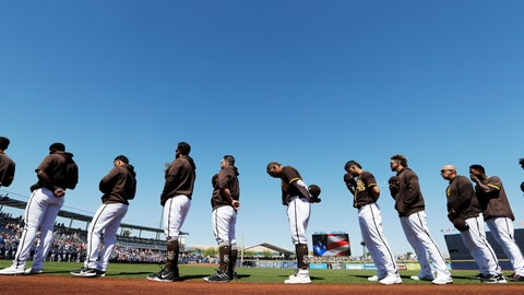 <p>               San Diego Padres players and coaches line up during playing of the national anthem before a spring training baseball game against the Los Angeles Dodgers, Monday, March 9, 2020, in Peoria, Ariz. (AP Photo/Elaine Thompson)             </p>