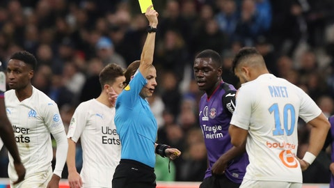 <p>               Referee Stephanie Frappart shows a yellow card to Toulouse's Jean-Victor Makengo, 2nd from right during a French League One soccer match between Marseille and Toulouse at the Stade Velodrome in Marseille, southern France, Saturday Feb. 8, 2020. (AP Photo/Daniel Cole)             </p>