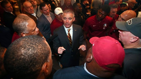 <p>               FILE - In this Sunday, Dec. 8, 2019, file photo, new Florida State NCAA college football head coach Mike Norvell talks to football staffers after a news conference, in Tallahassee, Fla. Norvell is taking over a Seminoles program that has struggled while he was helping to build Memphis into a Group of Five power. Florida State got in three practices before the new coronavirus outbreak shut down college sports and upended nearly everything else. (AP Photo/Phil Sears, File)             </p>