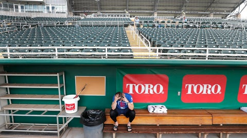 <p>               Minnesota Twins catcher Mitch Garver talks on his phone in an empty Hammond Stadium, Thursday, March 12, 2020, in Fort Myers, Fla. Major League Baseball has suspended the rest of its spring training game schedule because if the coronavirus outbreak. MLB is also delaying the start of its regular season by at least two weeks. (AP Photo/Elise Amendola)             </p>