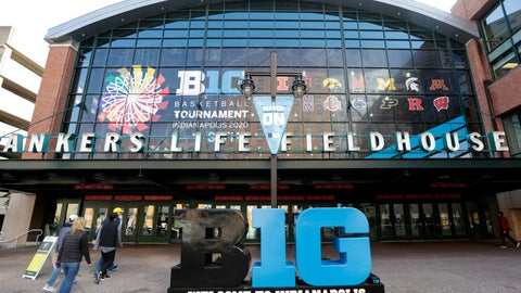 <p>               UPDATES TOURNAMENT CANCELLED - Fans enter The Bankers Life Fieldhouse for a game at the Big Ten Conference tournament in Indianapolis, Thursday, March 12, 2020. The Big Ten Conference announced that remainder of the men's NCAA college basketball games tournament was cancelled. (AP Photo/Michael Conroy)             </p>