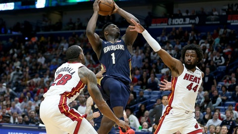 <p>               New Orleans Pelicans forward Zion Williamson (1) goes up for a basket as Miami Heat guard Andre Iguodala (28) and forward Solomon Hill (44) defend during the second half of an NBA basketball game in New Orleans, Friday, March 6, 2020. (AP Photo/Rusty Costanza)             </p>