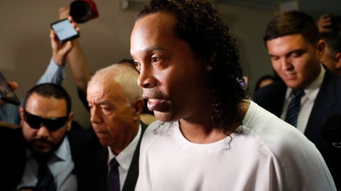 <p>               Former soccer star Ronaldinho is escorted by police to go before Judge Mirko Valinotti at the Justice Palace court in Asuncion, Paraguay, Friday, March 6, 2020.  Ronaldinho has been detained by Paraguayan police for allegedly entering the country with a falsified passport. (AP Photo/Jorge Saenz)             </p>