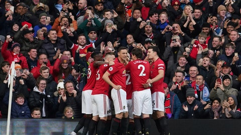 <p>               Manchester United's team players celebrate after Anthony Martial scored the opening goal during the English Premier League soccer match between Manchester United and Manchester City at Old Trafford in Manchester, England, Sunday, March 8, 2020. (AP Photo/Dave Thompson)             </p>