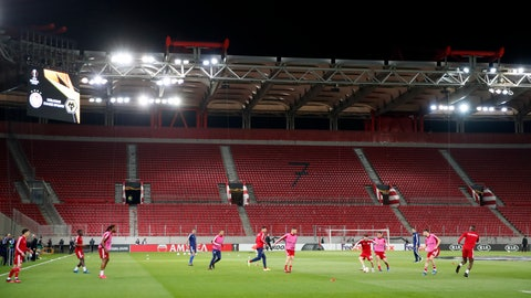 <p>               Olympiakos players challenge for the ball during warm up prior the Europa League round of 16 first leg soccer match between Olympiakos and Wolverhampton Wanderers at the Karaiskakis Stadium in Piraeus, Greece, Thursday, March 12, 2020. The match is being played in an empty stadium because of the coronavirus outbreak. (AP Photo/Thanassis Stavrakis)             </p>