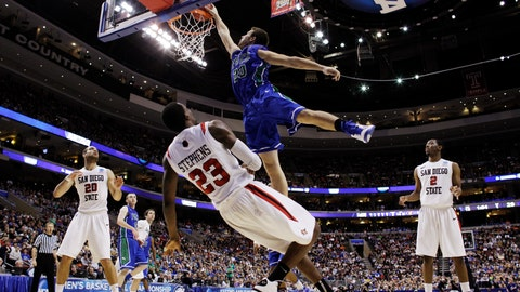 <p>               FILE - In this March 24, 2013, file photo, Florida Gulf Coast's Chase Fieler, top, dunks over San Diego State's Deshawn Stephens during the first half of a third-round game of the NCAA college basketball tournament in Philadelphia. The Dunk City Effect, as it's called, accounted for a 35 percent increase in freshman applications following the NCAA run, boosted enrollment from about 13,000 to  more than 15,000, and the academic reputation has been enhanced with higher caliber students being admitted. (AP Photo/Matt Slocum, File)             </p>