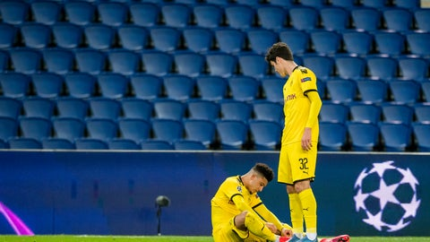 <p>               Borussia Dortmund's Jason Sancho and Giovanni Reyna, right, react after Paris Saint Germain's victory at the end of the Champions League round of 16 second leg soccer match between PSG and Borussia Dortmund, Wednesday March 11, 2020 in Paris. The match is being played in an empty stadium because of the coronavirus outbreak. (UEFA via AP)             </p>