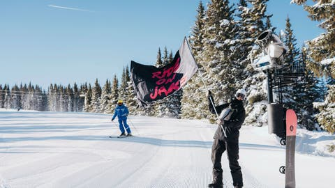 "<p>               In a photo provided by Burton, a fan of Jake Burton Carpenter waves one of dozens of ""Ride On Jake"" flags that dotted the course in Vail, Colo., Friday, Feb. 28, 2020. Skiers and snowboarders alike gathered over the weekend to celebrate Carpenter, who died November 2019 of testicular cancer. It was Carpenter who envisioned what snowboarding could be back in the 1980s and started producing snowboards to help his vision become reality. (Dean Blotto Gray/Burton via AP)             </p>"