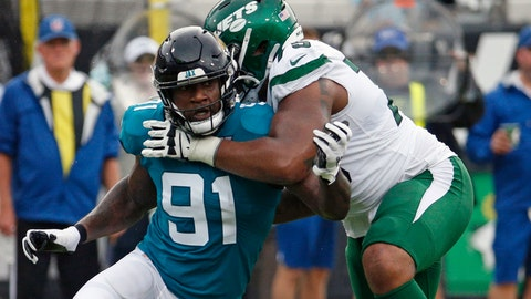 <p>               FILE - In this Oct. 27, 2019, file photo, Jacksonville Jaguars defensive end Yannick Ngakoue (91) rushes New York Jets offensive tackle Chuma Edoga during the first half of an NFL football game in Jacksonville, Fla. Standout defensive end Yannick Ngakoue no longer wants to sign a long-term deal with the Jacksonville Jaguars. Ngakoue announced his desire to play elsewhere via social media Monday, March 2, 2020, a move that could force the team to place the franchise tag on the 24-year-old disgruntled defender and trade him.(AP Photo/Stephen B. Morton, File)             </p>