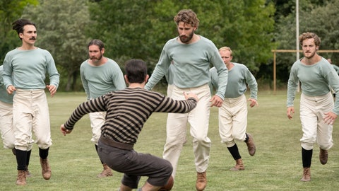 "<p>               This image released by Netflix shows Kevin Guthrie, foreground center, and Edward Holcroft, background center, in a scene from ""The British Game,"" a six-part drama charting the origins of soccer. (Oliver Upton/Netflix via AP)             </p>"