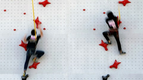 <p>               Tokyo 2020 Olympic Games Organizing staffs climb the wall in the test event of Speed Climbing in preparation for the Tokyo 2020 Olympic Games at Aomi Urban Sports Park Friday, March 6, 2020, in Tokyo. The recent outbreak of the coronavirus has forced them to cancel or postpone several. But they allowed a sport climbing event on Friday to go ahead, with a few restrictions: like the absence of elite athletes.  (AP Photo/Eugene Hoshiko)             </p>