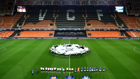 <p>               Atalanta and Valencia players line up ahead of the Champions League round of 16 second leg soccer match between Valencia and Atalanta in Valencia, Spain, Tuesday March 10, 2020. The match is being in an empty stadium because of the coronavirus outbreak. (UEFA via AP)             </p>