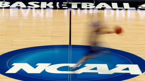 "<p>               FILE - In this March 14, 2012, file photo, a player runs across the NCAA logo during practice at the NCAA tournament college basketball in Pittsburgh. The NCAA Board of Governors took the first step Tuesday, Oct. 29, 2019, toward allowing athletes to cash in on their fame, voting unanimously to clear the way for the amateur athletes to ""benefit from the use of their name, image and likeness."" (AP Photo/Keith Srakocic, File)             </p>"