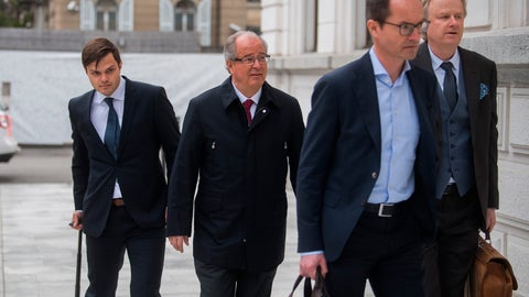 <p>               Former FIFA Secretary-General Urs Linsi, center, and his lawyers arrive at the Federal Criminal Court in Bellinzona, Switzerland, Monday, March 9, 2020. Three former German football officials and ex-FIFA Secretary-General Urs Linsi will go on trial over suspicions that Germany bought votes to obtain the 2006 Soccer World Cup. (Samuel Golay/Keystone via AP)             </p>