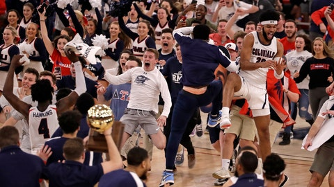 <p>               Robert Morris fans run onto the court as the team celebrates following a 77-67 win over St. Francis in an NCAA college basketball game for the Northeast Conference men's tournament championship in Pittsburgh, Tuesday, March 10, 2020. (AP Photo/Gene J. Puskar)             </p>