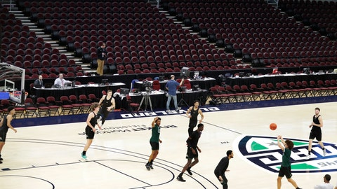 <p>               Ohio University basketball players warm up in an empty arena without fans before an NCAA college basketball game against Akron in the Mid-American Conference men's tournament, Thursday, March 12, 2020, in Cleveland. The Mid-American Conference tournament was cancelled Thursday, at an arena scheduled to be the site of NCAA men's tournament games next week .(AP Photo/Tony Dejak)             </p>