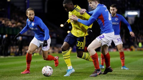 <p>               Arsenal's Eddie Nketiah, left, challenges for the ball with Portsmouth's Steve Seddon during the English FA Cup fifth round soccer match between Portsmouth and Arsenal at Fratton Park stadium in Portsmouth, England, Monday, March 2, 2020. (AP Photo/Kirsty Wigglesworth)             </p>
