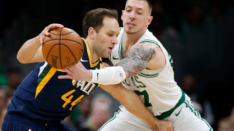 <p>               Boston Celtics' Daniel Theis, right, tries to knock the ball away from Utah Jazz's Bojan Bogdanovic during the fourth quarter of an NBA basketball game Friday, March 6, 2020, in Boston. (AP Photo/Winslow Townson)             </p>