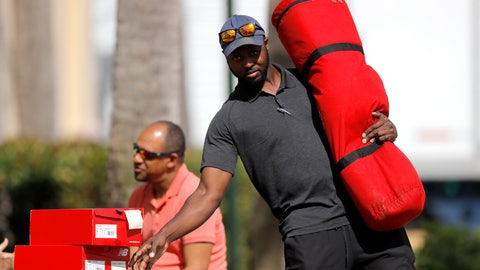 <p>               St. Louis Cardinals minor league outfielder Bradley Roper-Hubbert carries gear as he leaves the team's spring training baseball clubhouse, Friday, March 13, 2020, in Jupiter, Fla. Major League Baseball has delayed the start of its season by at least two weeks because of the coronavirus outbreak as well as suspended the rest of its spring training game schedule. (AP Photo/Julio Cortez)             </p>