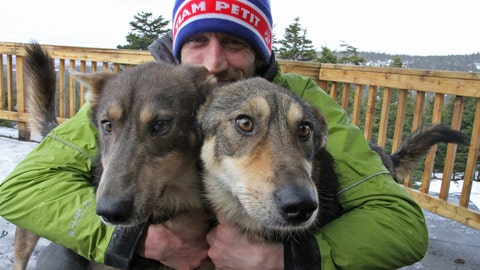 <p>               FILE - In this March 20, 2019, file photo, Iditarod musher Nicolas Petit, of France, poses with two of his dogs in Anchorage, Alaska. Nearly a third of the 57 mushers in this year's Iditarod Trail Sled Dog Race have quit the race before finishing, including Petit, who activated an alert button seeking rescue Thursday morning, March 19, 2020, because of weather conditions. (AP Photo/Mark Thiessen, File)             </p>