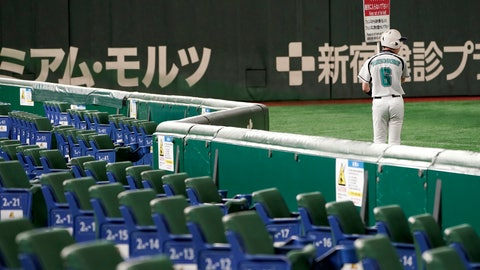 <p>               In this Feb. 29, 2020, photo, a ball boy walks with notice next to empty spectators' seats during play in a preseason baseball game between the Yomiuri Giants and the Yakult Swallows at Tokyo Dome in Tokyo. Japanese officials said Monday, March 9, 2020 they are postponing the start of the 12-team professional baseball league season because of the spread of the coronavirus. (AP Photo/Eugene Hoshiko)             </p>