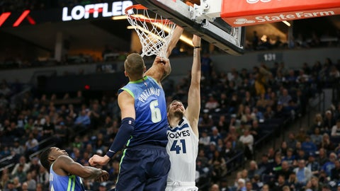 <p>               Minnesota Timberwolves' Juancho Hernangomez (41) tries to shoot around Dallas Mavericks' Kristaps Porzingis (6) in the first half of an NBA basketball game Sunday, March 1, 2020, in Minneapolis. (AP Photo/Stacy Bengs)             </p>