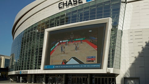 <p>               The Chase Center, home of NBA basketball's Golden State Warriors, show a pre-recorded video of a basketball game on a large screen at the entrance to the areana on a day the team was to play the Brooklyn Nets, Thursday, March 12, 2020, in San Francisco. The NBA suspended its season after a Utah Jazz player tested positive Wednesday for the coronavirus. (AP Photo/Ben Margot)             </p>