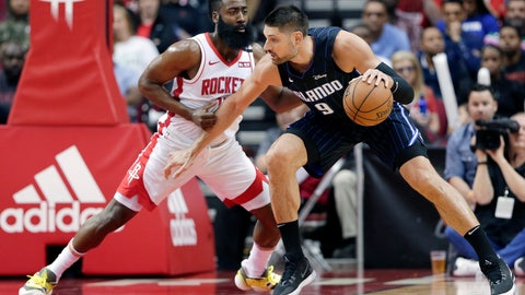 <p>               Orlando Magic center Nikola Vucevic (9) attempts to drive around Houston Rockets guard James Harden, left, during the first half of an NBA basketball game Sunday, March 8, 2020, in Houston. (AP Photo/Michael Wyke)             </p>