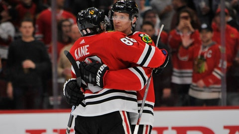 <p>               Chicago Blackhawks' Patrick Kane (88) celebrates with teammate Dominick Kubalik (8) of the Czech Republic, after defeating the San Jose Sharks 6-2 in an NHL hockey game Wednesday, March 11, 2020, in Chicago. (AP Photo/Paul Beaty)             </p>