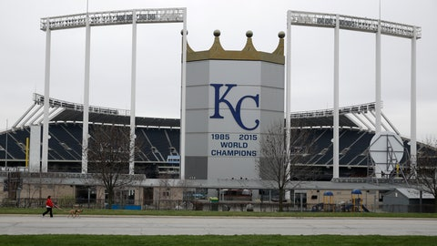 <p>               A woman and her dog walk past Kauffman Stadium, home of the Kansas City Royals baseball team, Wednesday, March 25, 2020, in Kansas City, Mo. The start of the regular season, which was set to start on Thursday, is on hold indefinitely because of the coronavirus pandemic. (AP Photo/Charlie Riedel)             </p>