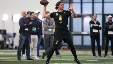 <p>               Quarterback Justin Herbert works out during Oregon football pro day in Eugene, Ore., Thursday, March 12, 2020. (AP Photo/Collin Andrew)             </p>