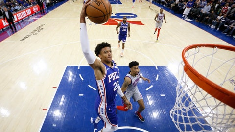 <p>               Philadelphia 76ers' Matisse Thybulle (22) goes up for a dunk past Detroit Pistons' Christian Wood (35) during the first half of an NBA basketball game, Wednesday, March 11, 2020, in Philadelphia. (AP Photo/Matt Slocum)             </p>