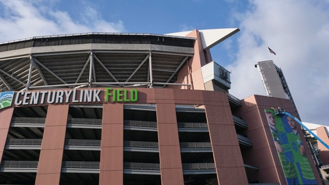 <p>               A crew works on a banner featuring Seattle Sounders MLS soccer players outside of CenturyLink Field, Wednesday, March 11, 2020, in Seattle. In efforts to slow the spread of the COVID-19 coronavirus, Washington State Gov. Jay Inslee announced a ban on large public gatherings in three counties in the metro Seattle area. That decision impacts the Seattle Mariners, Seattle Sounders, and the XFL's Seattle Dragons home games. (AP Photo/Stephen Brashear)             </p>