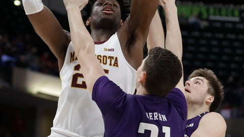 <p>               Minnesota's Daniel Oturu (25) puts up a shot over Northwestern's Robbie Beran (31) during the first half of an NCAA college basketball game at the Big Ten Conference tournament, Wednesday, March 11, 2020, in Indianapolis. (AP Photo/Darron Cummings)             </p>