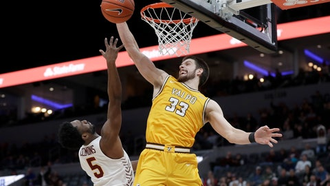 <p>               Valparaiso's John Kiser (33) knocks the ball away from Loyola of Chicago's Keith Clemons (5) during the second half of an NCAA college basketball game in the quarterfinal round of the Missouri Valley Conference men's tournament Friday, March 6, 2020, in St. Louis. Valparaiso won 74-73 in overtime. (AP Photo/Jeff Roberson)             </p>