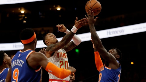 <p>               Atlanta Hawks forward John Collins (20) battles New York Knicks forward Julius Randle (30) as he drives to the basket during the first half of an NBA basketball game Wednesday, March 11, 2020, in Atlanta. (AP Photo/John Bazemore)             </p>