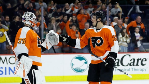 <p>               Philadelphia Flyers' Carter Hart (79) and Justin Braun (61) celebrate after an NHL hockey game against the Buffalo Sabres, Saturday, March 7, 2020, in Philadelphia. Philadelphia won 3-1. (AP Photo/Matt Slocum)             </p>