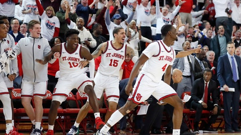 <p>               St. John's forwards Marcellus Earlington (10) and Damien Sears (15) along with guard Greg Williams Jr. (4) react from the bench during thewaning minutes of the second half of an NCAA college basketball game against Creighton, Sunday, March 1, 2020, in New York. St. Johns upset Creighton 91-71. (AP Photo/Kathy Willens)             </p>