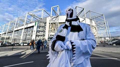 <p>               A Borussia fan dressed as ghost stands in front of the stadium prior the German Bundesliga soccer match between Borussia Moenchengladbach and 1.FC Cologne in Moenchengladbach, Germany, Wednesday, March 11, 2020. It is the first Bundesliga match played behind closed doors without spectators due to the coronavirus outbreak. For most people, the new coronavirus causes only mild or moderate symptoms, such as fever and cough. For some, especially older adults and people with existing health problems, it can cause more severe illness, including pneumonia. (AP Photo/Martin Meissner)             </p>
