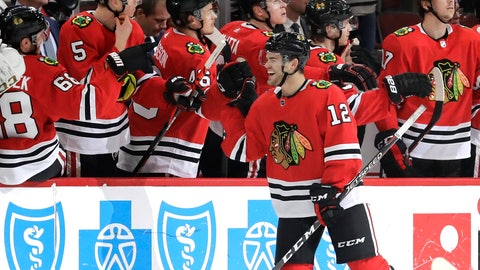 <p>               Chicago Blackhawks left wing Alex DeBrincat (12) celebrates with teammates after scoring a goal during the second period of an NHL hockey game against the Edmonton Oilers in Chicago, Thursday, March 5, 2020. (AP Photo/Nam Y. Huh)             </p>