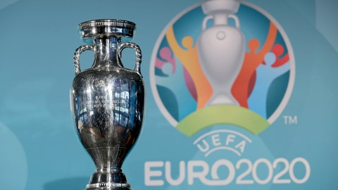 <p>               FILE - In this Thursday, Oct. 27, 2016 file photo the Euro soccer championships trophy is seen in front of the logo during the presentation of Munich's logo as one of the host cities of the Euro 2020 European soccer championships in Munich, Germany. UEFA, are set to make a final decision when the UEFA executive committee meets on Tuesday March 17, 2020 after talks with clubs and leagues, about possibly delaying the Euro 2020 soccer tournament by a year as the continent grapples with the outbreak of the coronavirus. (AP Photo/Matthias Schrader, File)             </p>