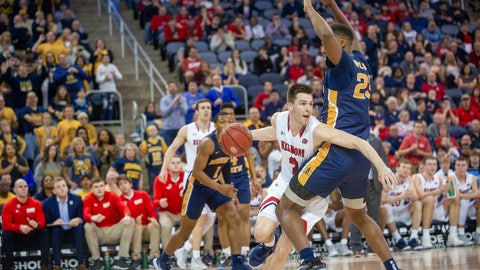 <p>               Belmont's Grayson Murphy (2) moves around Murray State's KJ Williams (23) during the second half of an NCAA college basketball game for the championship of the Ohio Valley Conference men's tournament Saturday, March 7, 2020, in Evansville, Ind. (AP Photo/Daniel R. Patmore)             </p>